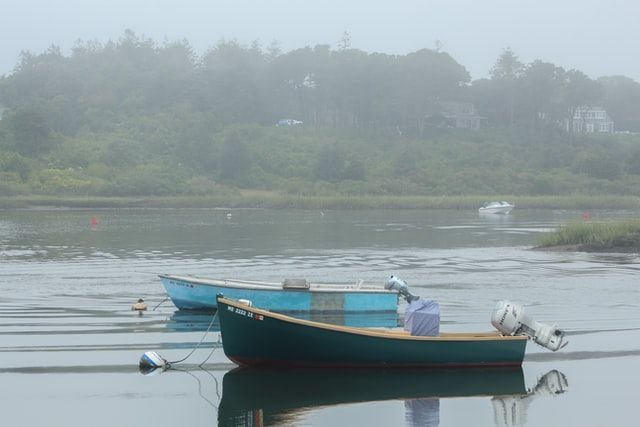 Two small boats docked on Chatham Port