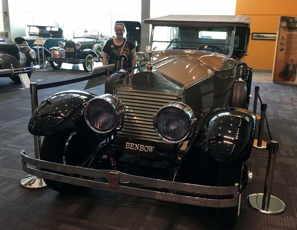 A woman standing beside a 1925 Springfield Rolls Royce at the Elliott Museum in Stuart